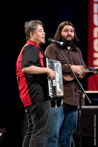 Joey deVilla on accordion and Chad Fowler on ukelele, onstage at RailsConf 2007.