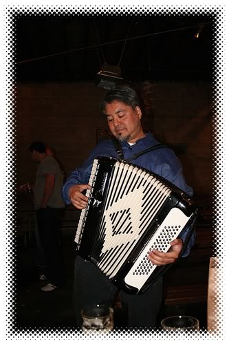 Joey deVilla playing accordion at the Lucky Labrador