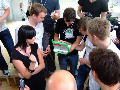 Tom Purves' photo of people gatehring around the OLPC at Reboot 9.