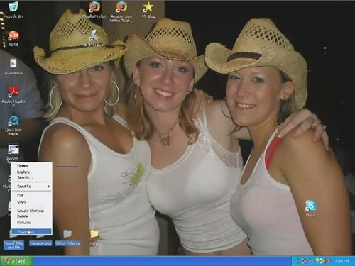 Desktop of the computer used in the Consumerist sting: three women in cowboy hats and skimpy tanktops.