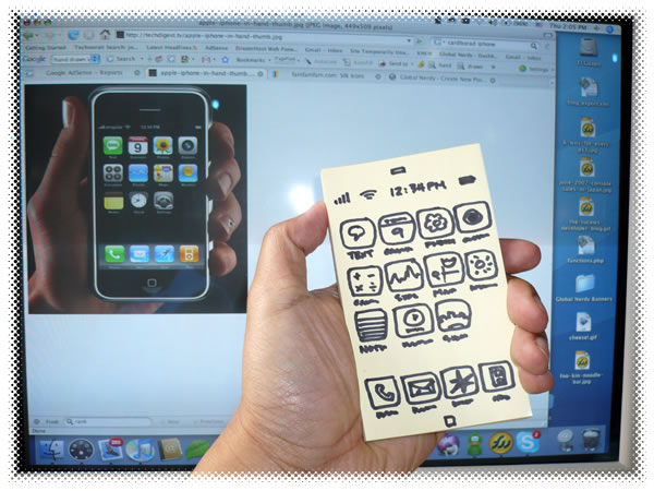 Photo: Hand-drawn iPhone held in front of a monitor showing a real iPhone.