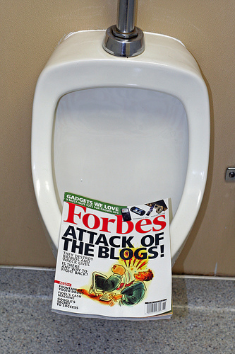 Copy of Forbes November 14, 2005 issue in a urinal.