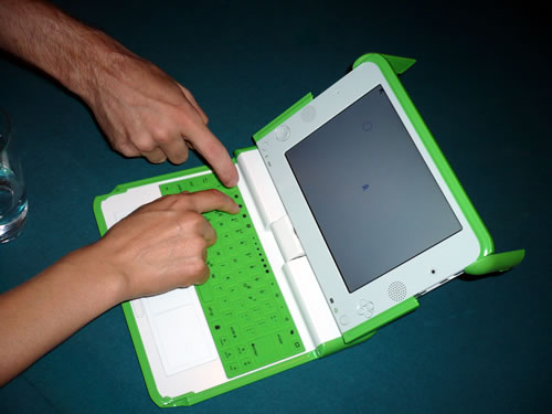 The OLPC and adult hands.