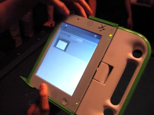 "OLPC in ""book/tablet"" configuration."