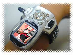 "Wrist mobile phone displaying an image of Joey ""Accordion Guy"" deVilla playing the accordion."