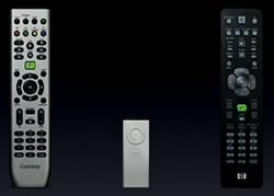 Remote controls, including the very simple AppleTV remote.