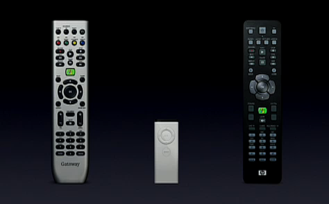 Two complex TV remotes and the very simple Apple TV remote