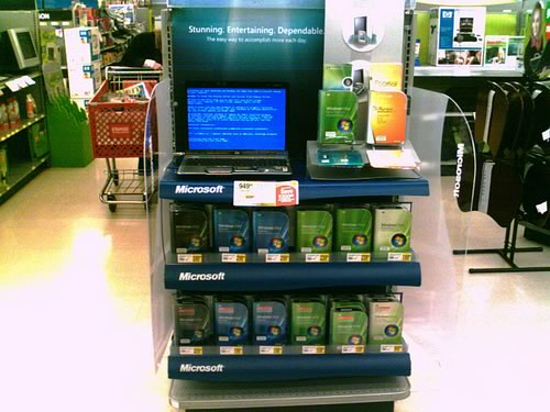 """Computer store display for Vista: """"Stunning. Entertaining. Dependable"""", with a machine showing a blue screen of death."""
