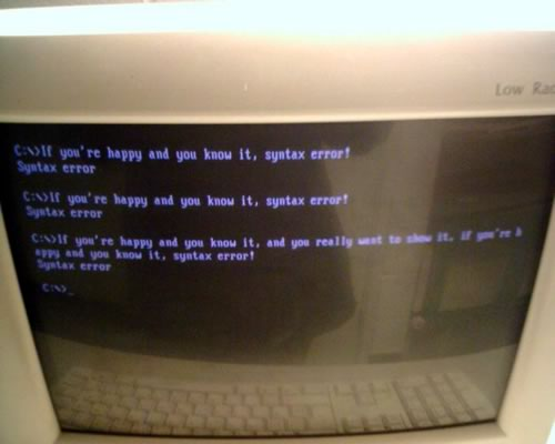 "Computer monitor: ""If you're happy and you know it, syntax error!"""