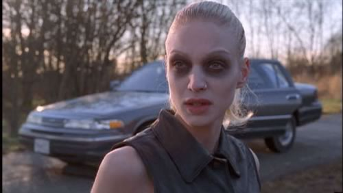 "Invisigoth from the ""X-Files"" episode ""Kill Switch"" — a skinny pale blonde woman, dressed in black, wearing way too much makeup."