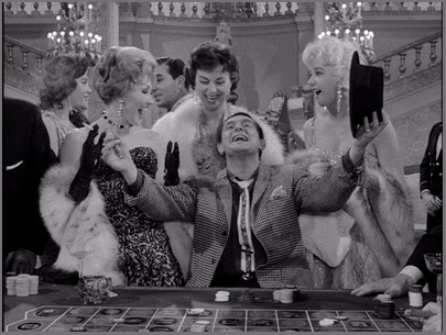 Man surrounded by women at a casino, winning