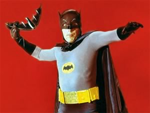 The Adam West Batman, hurling his batarang