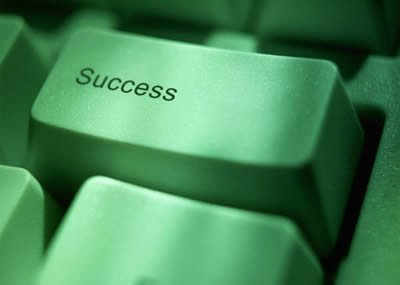"Key on a computer keyboard labelled ""Success"""