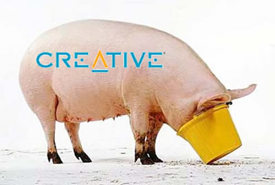 "Pig labelled ""Creative Labs"" gorging on food in a bucket."