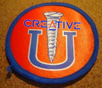 "A ""Screw U"" patch with the Creative Labs logo overlay."