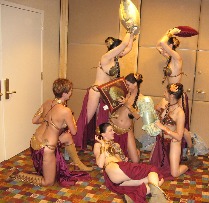 "6 women in ""Princess Leia Slave\"" costumes having a pillow fight"