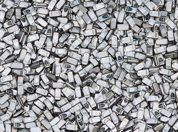 """Coming Soon to a Landfill Near You\"": A giant pile of discarded mobile phones."