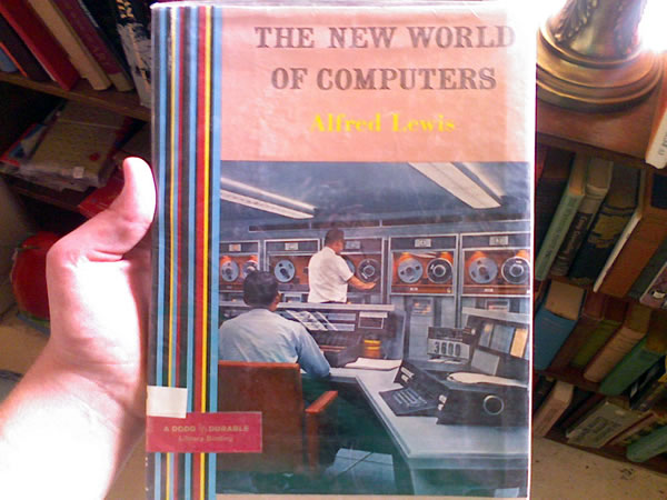 "Old book: ""The New World of Computers\"", featuring a late-\'60s or \'70s-era mainframe"