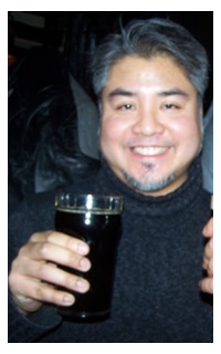 Joey deVilla holding a beer