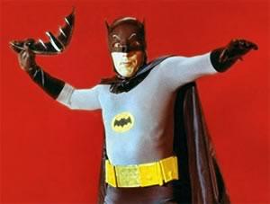 The Adam West Batman, hurling his batarang