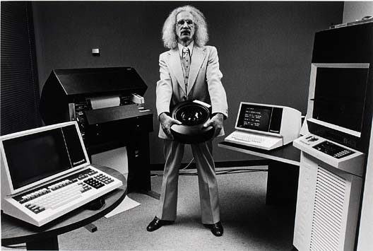Wild-haired guy surrounded by old computers